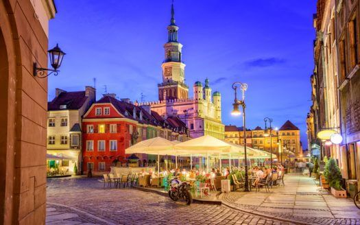 Cafes on the main square of the old town of Poznan, Poland on a summer day evening.