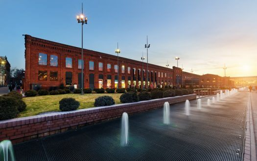Shopping Mall in Lodz transformed from industrial buildings into elegant place for shopping on the sunset, Poland